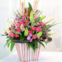 Pink & Purple bouquet in container